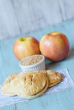 Red Apples and Hand Pies with Raw Sugar Vertical Royalty Free Stock Image