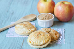 Red Apples and Hand Pies with Raw Sugar Stock Photography