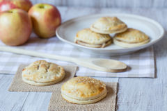 Red Apples And Hand Pies with Wood Spoon Royalty Free Stock Photography