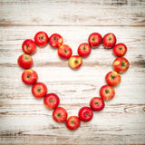 Red apples heart wooden background. Love concept vintage Stock Photography