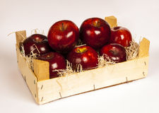 Red apples. Inside wooden box on white bacground Stock Photo