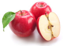 Red apples with leaf and half of apple Royalty Free Stock Photography