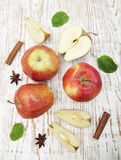 Red apples. With leaves on old wooden table royalty free stock photography