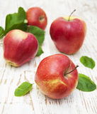 Red apples. With leaves on old wooden table stock photos