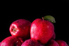 Red apples with leaves on the table stock photos