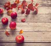 Red apples and leaves on  wooden background Stock Photography