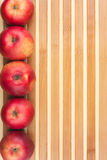 Red  apples lie on  bamboo mat Stock Images