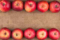 Red apples lie on sackcloth Royalty Free Stock Photo