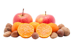 Red apples, mandarins with drops and nuts isolated Royalty Free Stock Image