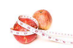Red apples with measure tape Stock Image