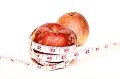 Red apples with measure tape Stock Photography