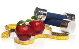 Red apples and a measuring tape Stock Image