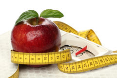 Red apples and a measuring tape Stock Images