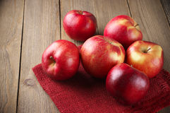 Red apples on napkin Stock Photo