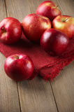 Red apples on napkin Stock Photos