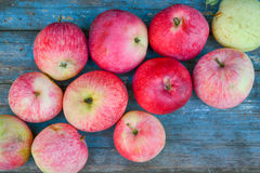 Red apples. Natural ripe red apples on a blue background Royalty Free Stock Image