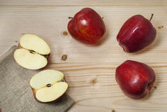 Red apples on natural wood. And hemp Stock Photography