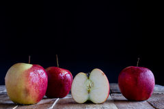 Red Apples on old table Royalty Free Stock Images