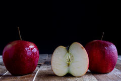 Red Apples on old table Stock Images