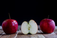Red Apples on old table Stock Photos