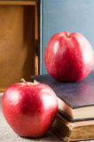 Red apples on the old vintage books Royalty Free Stock Images