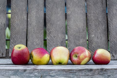 Red apples with old wood background. And details Royalty Free Stock Photography