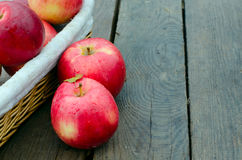 Red apples on old wood Stock Photos