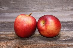 Red Apples on a old wooden background Royalty Free Stock Photo