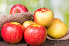 Red apples. On an old wooden surface stock image