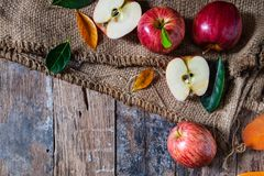 Red apples On old a wooden table. stock image