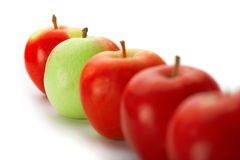 Red apples with one green one Royalty Free Stock Photography