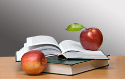 Red apples and open book Royalty Free Stock Image