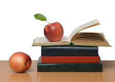 Red apples and open book Royalty Free Stock Images