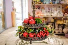 Red apples and other fruits in vase  decor Royalty Free Stock Images