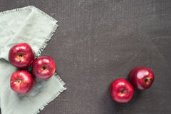 Red apples on a painted board Royalty Free Stock Photos