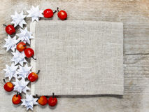 Red apples and paper stars on wood. En background. Copy space Stock Photos
