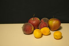 Red apples and peaches Royalty Free Stock Images