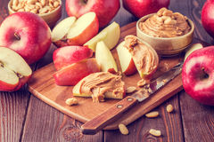 Red apples and peanut butter for snack Royalty Free Stock Photos