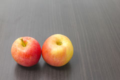 Red apples. Photo of freshly picked red apples on wooden background Stock Photos