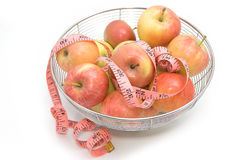 Red apples with pink measuring tape Stock Image