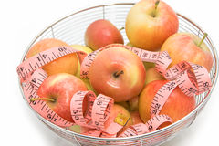 Red apples with pink measuring tape Stock Photo