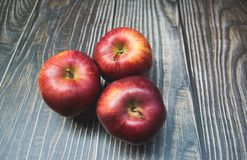 red apples placed on the wood royalty free stock photos