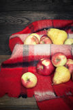 Red apples on a plaid Royalty Free Stock Image