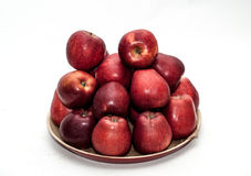 Red apples. On a plate Stock Image