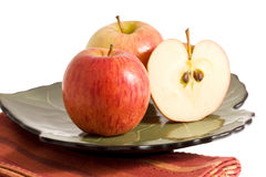 Red apples on the plate royalty free stock photo