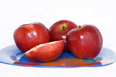 Red apples on the plate  Royalty Free Stock Images