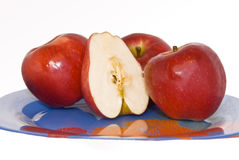 Red apples on the plate Royalty Free Stock Photos