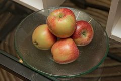 Red apples in the pot. Fresh raw organic fruit. Fresh raw organic fruit. Red apples in the pot Stock Images