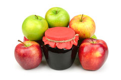 Red apples and pot of jam Stock Images