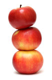 Red apples pyramid on white Stock Photo